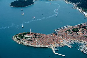 Pete McLeod of Canada performs infront of the city of Rovinj during the qualifying for the second stage of the Red Bull Air Race World Championship in Rovinj, Croatia on April 12, 2014.