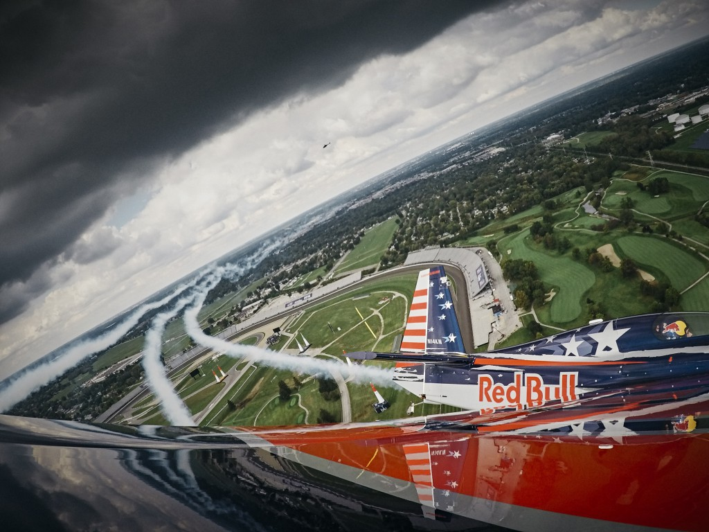 Kirby Chambliss of the United States flies over the Indianapolis Motor Speedway prior to the seventh stage of the Red Bull Air Race World Championship in Indianapolis, Indiana, United States on September 29, 2016.